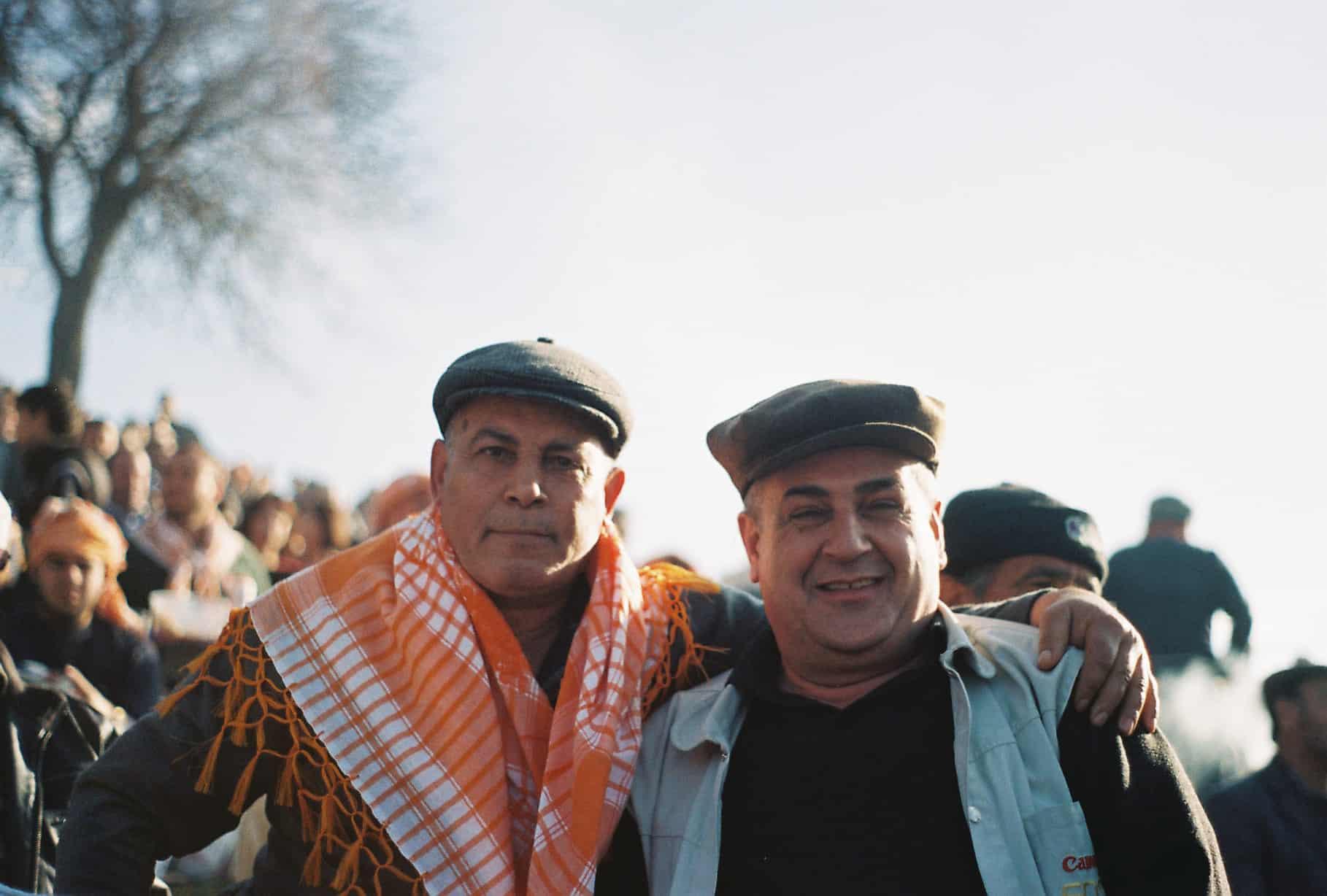 Two Men Posing (camel wrestling festival)