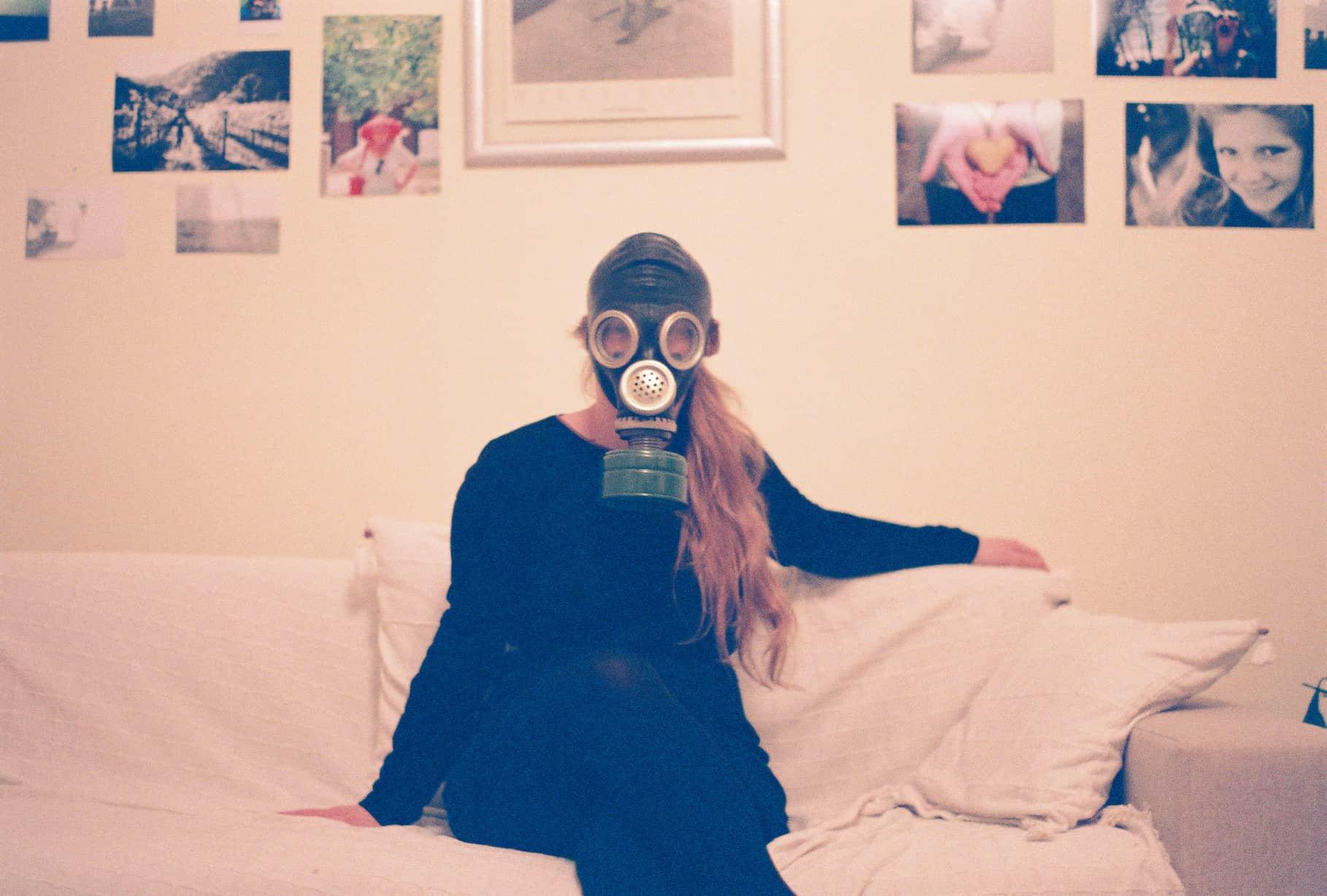 Katrinka at Home, with gas mask